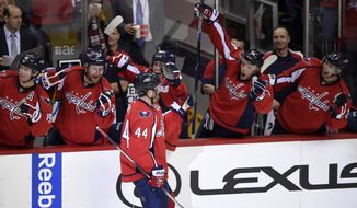 Washington Capitals defenseman Brooks Orpik (44) celebrates his goal with teammates on the bench during the third period of an NHL hockey game against the New Jersey Devils, Saturday, Feb. 20, 2016, in Washington. The Capitals won 4-3. (AP Photo/Nick Wass)