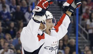 Washington Capitals center Jay Beagle celebrates after scoring against the Tampa Bay Lightning during the first period of an NHL hockey game Saturday, Dec. 12, 2015, in Tampa, Fla. (AP Photo/Chris O'Meara)