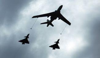 A Chinese military refueling tanker aircraft flies with fighter jets during rehearsals ahead of the Sept. 3 military parade to commemorate the end of World War II in Beijing on Aug. 23, 2015. (Associated Press)
