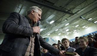 Commentator Glenn Beck, at left, gives a copy of Don Quijote to a supporter at a rally for Republican presidential candidate, Sen. Ted Cruz, R-Texas, Monday, Feb. 22, 2016, in Reno, Nev. (AP Photo/Marcio Jose Sanchez) ** FILE **