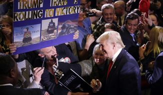 Republican presidential candidate Donald Trump greets supporters during a rally Tuesday, Feb. 23, 2016, in Reno, Nev. (AP Photo/Marcio Jose Sanchez)