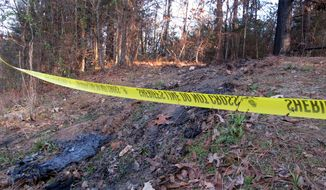 Yellow crime scene tape marks the location where 19-year-old Jessica Chambers was found severely burned on Dec. 10, 2014 in Courtland, Miss. (Associated Press)
