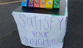 A business-savvy Girl Scout is funding her trip to horse camp by setting up her cookie stand outside a marijuana dispensary in Portland, Oregon. (KATU/Corry Young)