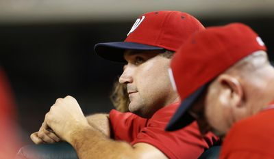 In this photo taken Aug. 4, 2014, Washington Nationals Ryan Zimmerman pauses in the dugout during a baseball game against the Philadelphia Phillies at Nationals Park in Washington. In his first interview since reporting to spring training, Zimmerman vigorously defended himself against performance-enhancing drug allegations made in a documentary that aired in December. (AP Photo/Alex Brandon)