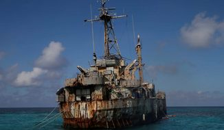 A dilapidated Philippine Navy ship LT 57 (Sierra Madre) with Philippine troops deployed on board is anchored off Second Thomas Shoal, locally known as Ayungin Shoal, Sunday, March 30, 2014 off South China Sea. On Saturday, China Coast Guard attempted to block the Philippine government vessel AM700 carrying fresh troops and supplies, but the latter successfully managed to docked beside the ship to replace troops who were deployed for five months. (AP Photo/Bullit Marquez) (Associated Press)