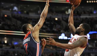 Chicago Bulls' Aaron Brooks (0), goes up for a shot against Washington Wizards' Ramon Sessions (7), during the second half of an NBA basketball game Wednesday, Feb. 24, 2016, in Chicago. Chicago won 109-104. (AP Photo/Paul Beaty)