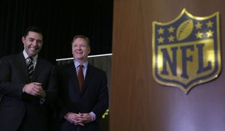 San Francisco 49ers owner Jed York, left, and NFL Commissioner Roger Goodell, center, smile at a news conference in San Francisco, Monday, Feb. 8, 2016. (AP Photo/Jeff Chiu)