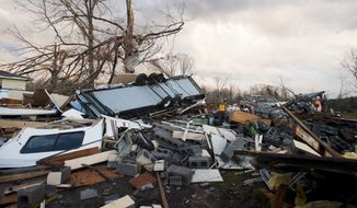 Tornado damage along Richmond Highway in Appomattox County is shown on Wednesday, Feb. 24, 2016.  State police say at least  seven people have been injured in Appomattox County, where a funnel cloud left an 8- to 10-mile path of destruction. (The News & Advance/News & Daily Advance via AP)