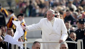 Pope Francis grabs a scarf tossed by a worshipper as he arrives to hold his weekly general audience in St. Peter's Square at the Vatican, Wednesday, Feb. 24, 2016. (AP Photo/Alessandra Tarantino)