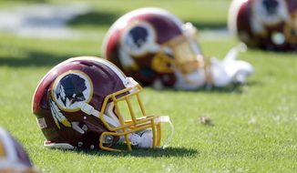 Washington Redskins' helmets on the sideline before an NFL football game against the Carolina Panthers in Charlotte, N.C., Sunday, Nov. 22, 2015. The Panthers won 44-16. (AP Photo/Bob Leverone)