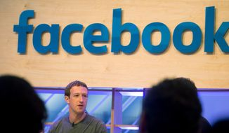 Facebook CEO Mark Zuckerberg speaks during a visit to a Facebook Innovation Hub in Berlin on Feb. 25, 2016. Zuckerberg presented studies on Artificial Intelligence. (Kay Nietfeld/dpa via AP) **FILE**