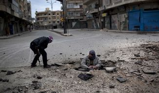 Free Syrian Army fighters plant a roadside bomb to destroy a Syrian Army tank during a day of fierce fighting with the government forces in Idlib, north Syria, in this March 11, 2012, file photo. (AP Photo/Rodrigo Abd, File)