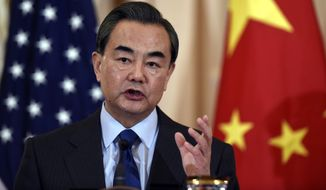"""""""We believe China's legitimate security concerns must be taken into account, and a convincing explanation must be provided to China,"""" said Chinese Foreign Minister Wang Yi, while conceding South Korea had the right to make its own decisions. """"I don't think it's too much to ask."""" (Associated Press)"""