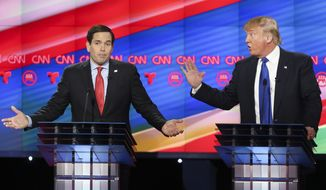Republican presidential candidates, Sen. Marco Rubio, R-Fla, left, and businessman Donald Trump argue while answering a question during the Republican Presidential Primary Debate at the University of Houston Thursday, Feb. 25, 2016. (AP Photo/Houston Chronicle, Gary Coronado, Pool)