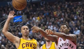 Toronto Raptors guard Kyle Lowry (7) moves the ball past Cleveland Cavaliers forward Richard Jefferson (24) during the first half of an NBA basketball game Friday, Feb. 26, 2016, in Toronto. (Nathan Denette/The Canadian Press via AP)