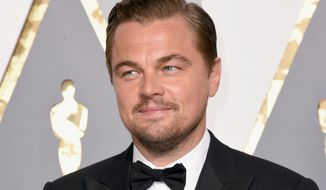 Leonardo DiCaprio arrives at the Oscars on Sunday, Feb. 28, 2016, at the Dolby Theatre in Los Angeles. (Photo by Dan Steinberg/Invision/AP)