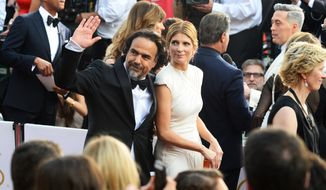 Alejandro Gonzalez Inarritu and Maria Eladia Hagerman arrive at the Oscars on Sunday at the Dolby Theatre in Los Angeles. (Associated Press)