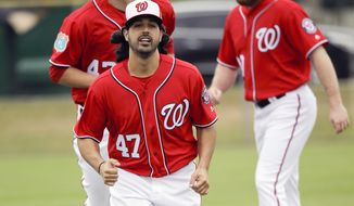 Washington Nationals pitcher Gio Gonzalez (47) runs sprints with teammates during a spring training baseball workout, Saturday, Feb. 20, 2016, in Viera, Fla. (AP Photo/John Raoux)