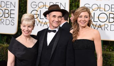 Claire van Kampen, Mark Rylance and Nataasha Van Kampen arrive at the 73rd annual Golden Globe Awards on Sunday, Jan. 10, 2016, at the Beverly Hilton Hotel in Beverly Hills, Calif. (Associated Press)