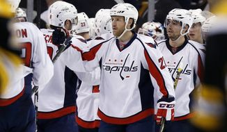 Washington Capitals' Brooks Laich (21) celebrates with teammates after the Capitals defeated the Boston Bruins 3-2 during an NHL hockey game in Boston, Tuesday, Jan. 5, 2016. (AP Photo/Michael Dwyer)