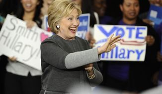 Democratic presidential candidate Hillary Clinton waves to the audience at a campaign event, Monday, Feb. 29, 2016, in Springfield, Mass. (AP Photo/Jessica Hill)