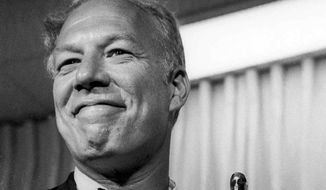 """George Kennedy poses with his Oscar on April 10, 1968 in Santa Monica, Calif, after he was presented with it as best supporting actor. He won the award for his role in the film """"Cool Hand Luke."""" It was his first Oscar. (Associated Press)"""