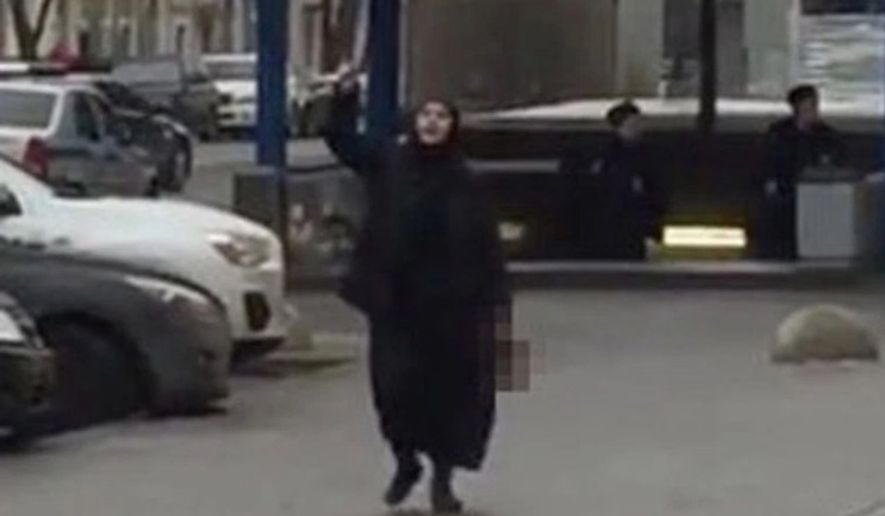 Russian police arrested a woman brandishing a child's severed head and threatening to activate a bomb outside a Moscow subway station on Monday, officials said. (YouTube via New York Post)