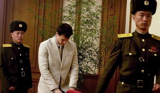 American student Otto Warmbier, center, arrives at the People's Cultural House, as Warmbier is presented to reporters Monday, Feb. 29, 2016, in Pyongyang, North Korea. North Korea announced late last month that it had arrested the 21-year-old University of Virginia undergraduate student. (AP Photo/Kim Kwang Hyon)