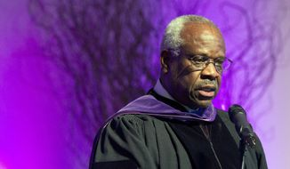 FILE - In this Jan. 26, 2012 file photo, Supreme Court Justice Clarence Thomas speaks at College of the Holy Cross in Worcester, Mass. Thomas has asked questions during Supreme Court arguments for the first time in 10 years. Thomas' question came Monday, Feb. 29, 2016, in a case in which the court is considering placing new limits on the reach of a federal law that bans people convicted of domestic violence from owning guns.   (AP Photo/Michael Dwyer, File)