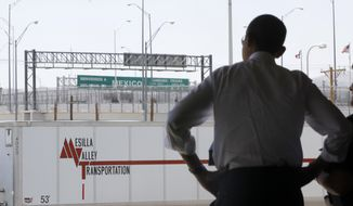President Obama looks towards Mexico as he tours the Bridge of America Cargo Facility in El Paso, Texas, on May 10, 2011, as he visited the U.S.-Mexico border to speak about immigration reform. (Associated Press) **FILE**