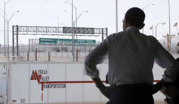 President Obama looks toward Mexico as he tours the Bridge of America Cargo Facility in El Paso, Texas, on May 10, 2011, as he visited the U.S.-Mexico border to speak about immigration reform. (Associated Press) **FILE**