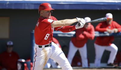 Washington Nationals' Danny Espinosa swings at a pitch during an intrasquad baseball game at a spring training workout, Sunday, Feb. 28, 2016, in Viera, Fla. (AP Photo/John Raoux)