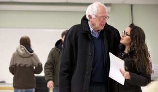 Democratic presidential candidate Sen. Bernie Sanders, I-Vt., is hugged by a voter after voting in the Vermont primary at the Robert Miller Community and Recreation Center in Burlington, Vermont, Tuesday, March 1, 2016, on Super Tuesday. (AP Photo/Jacquelyn Martin)???