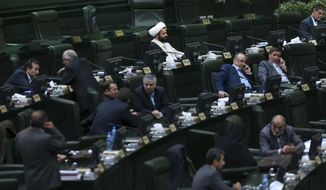 Iranian lawmakers attend an open session of the outgoing parliament in Tehran, Iran, Tuesday, March 1, 2016. A coalition of moderates and reformists gained bigger ground in the new parliament after Friday elections, the biggest presence of the camp over the past decade. The new parliament will take office in late May. (AP Photo/Vahid Salemi)