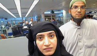 In this July 27, 2014 file photo provided by U.S. Customs and Border Protection shows Tashfeen Malik, left, and her husband, Syed Farook, at O'Hare International Airport in Chicago. (U.S. Customs and Border Protection via AP, File)