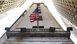 In this Friday, Nov. 13, 2015, file photo, an American flag flies above the Wall Street entrance to the New York Stock Exchange. (AP Photo/Richard Drew, File) **FILE**
