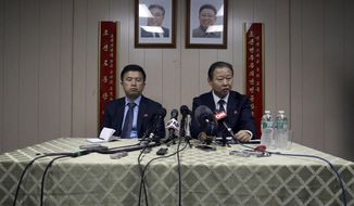 FILE - In this July 28, 2015 file photo, under the portraits of the late North Korean leaders, Kim Il Sung, left, and Kim Jong Il, ambassador of the Permanent Mission of the Democratic People's Republic of Korea to the United Nations Jang Il Hun, right, is joined by councilor Kwon Jong Gun as he speaks during a new conference at the DPRK mission in New York. A U.N. Security Council vote on the toughest sanctions on North Korea in two decades has been postponed until Wednesday morning at Russia's request, the United States and France said Tuesday, March 1, 2016. (AP Photo/Mary Altaffer, File)
