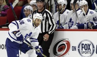 Toronto Maple Leafs' Daniel Winnik (26) skates against the Carolina Hurricanes during the first period of an NHL hockey game in Raleigh, N.C., Thursday, Dec. 18, 2014. (AP Photo/Gerry Broome)