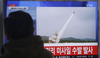 "A man watches a TV news program showing a file footage of the missile launch conducted by North Korea, at Seoul Railway Station in Seoul, South Korea, Thursday, March 3, 2016. North Korea fired several short-range projectiles into the sea off its east coast Thursday, Seoul officials said, just hours after the U.N. Security Council approved the toughest sanctions on Pyongyang in two decades for its recent nuclear test and long-range rocket launch. The screen reads "" North Korea launched missiles.""  (AP Photo/Ahn Young-joon)"