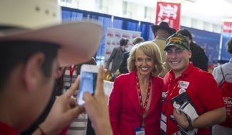 Former Arizona Gov. Jan Brewer poses with Justin Carrizales with the Leadership Institute on the first day of the American Conservative Union CPAC 2016 at the Gaylord National Resort and Convention Center in National Harbor, Md., Thursday, March 3, 2016. (Photo Rod Lamkey Jr.)