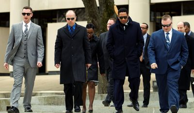 Three of six Baltimore city officers charged in connection to the death of Freddie Gray, leave the Maryland Court of Appeals, which heard oral arguments in five cases related to the arrest and death of Gray.