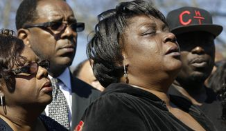 Rolonda Byrd, who says she is the mother of shooting victim Akiel Denkins, cries during a news conference near the scene of the shooting in Raleigh, N.C., on Tuesday. Authorities say that a police officer fatally shot a man Monday while trying to make an arrest for a felony drug charge. (Associated Press)