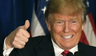 Republican presidential candidate Donald Trump gives a thumbs-up as he speaks at campaign stop, Thursday, March 3, 2016, in Portland, Maine. (AP Photo/Robert F. Bukaty)