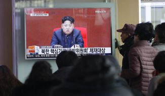 People watch a TV news program showing North Korean leader Kim Jong Un, at Seoul Railway Station on Thursday. (Associated Press)