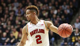 Maryland guard Melo Trimble controls the basketball against Purdue in the first half of an NCAA college basketball game, Saturday, Feb. 27, 2016, in West Lafayette, Ind. Purdue won 83-79.  (AP Photo/R Brent Smith)