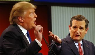 Republican presidential candidates, businessman Donald Trump and Sen. Ted Cruz, R-Texas, argue a point during a Republican presidential primary debate at Fox Theatre, Thursday, March 3, 2016, in Detroit. (AP Photo/Paul Sancya) ** FILE **