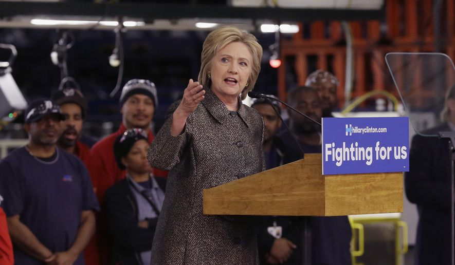 Democratic presidential candidate, Hillary Clinton speaks at the Detroit Manufacturing Systems plant, Friday, March 4, 2016, in Detroit. (AP Photo/Carlos Osorio)