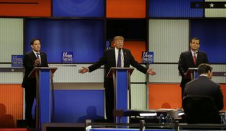 Republican presidential candidates, Sen. Marco Rubio, R-Fla., and businessman Donald Trump argue a point as Sen. Ted Cruz, R-Texas, right, reacts during a Republican presidential primary debate at Fox Theatre, Thursday, March 3, 2016, in Detroit. (AP Photo/Carlos Osorio)