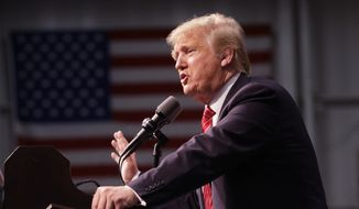 Republican presidential candidate Donald Trump speaks during a rally at Macomb Community College, Friday, March 4, 2016, in Warren, Mich. (AP Photo/Carlos Osorio)