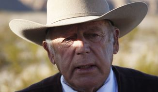 Rancher Cliven Bundy speaks to media while standing along the road near his ranch, in Bunkerville, Nev., in this Jan. 27, 2016, file photo. (AP Photo/John Locher, File)